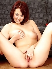 Lovely redhead schoolgirl stripping and dancing on the black sofa